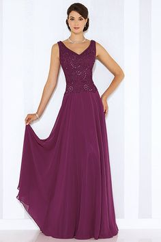 Sleeveless chiffon A-line gown with front and back V-necklines, ribbon work bodice and flyaway skirt. Matching shawl included.Available Colors: Heather, Dark Raspberry, Navy Blue, Persian Blue, RoseEnter to win dresses for mom, a David Tutera consult and more ?