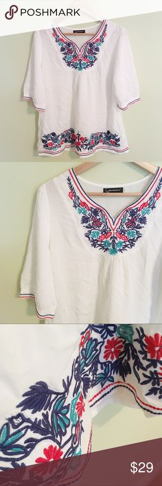 100% Cotton Embroidered Floral Top 100% Cotton Embroidered Floral Top.white with blue, red and aqua embroidery on bust, hem and sleeves. Half sleeve. Listed as anthro for exposure, brand is Modern Devil - purchased at a super cute boutique in Aruba. In like new condition. Size large is approx 22.5in pit to pit, 27.5in long. Anthropologie Tops Blouses