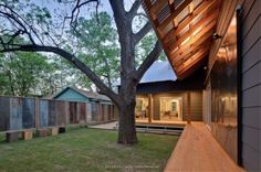 Moontower Residence contemporary landscape - LoVe the fence...rustic look!