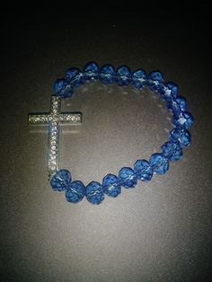 Pretty blue party jewelry bracelet. Blue beads with silver allow cross & faux diamond accents. Stretchy band fits most. Beautiful & shiny, new without tags. Handmade.   Offers always welcome! Expedited shipping & free gift wrapping available upon request.