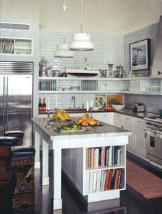 Kitchen featuring recessed fridge, bookcase for cookbooks (by Steven Sclaroff)