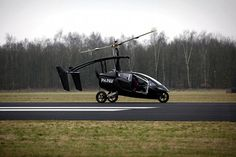 "The ""PAL V Flying Car Concept"" is a single-row twin-seater car/helicopter hybrid that can achieve speeds of up to 112 mph on the ground and 4,000 feet above."