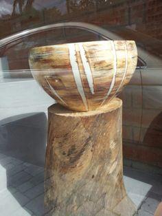 Ceramic piece, in wood color.