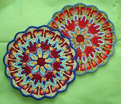 overlay crochet mandala Ok. So I know that these are made of that teeny tiny crochet thread, yea right. I bet these would look awesome as rugs made will regular worsted yarn.