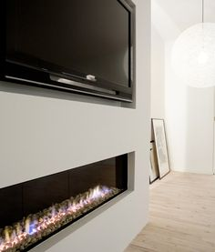 Modern fireplace with custom metal firebox and 36 ...
