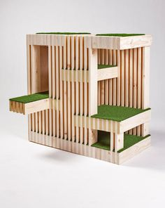 """<p>RNL<br /> """"Curiosity doesn't have to kill the cat.  Our Kitty Condo allows Felix to survey the environs from multiple turf-lined vantage points while comfortably hiding behind 23 layers of wood slats, which protect him from the Dyson'ator and Roomba-raptor.""""</p>"""