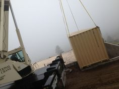 Placing a container for a container house in the mountains in Colorado
