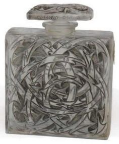 Rene Lalique Perfume Bottle Ambre Indien:8.5 centimeters tall with matching vine design all over the body and stopper