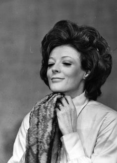 Just a simple smile. Maggie Smith.