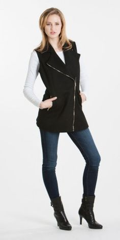 Cozy up in this black vest with gold hardware