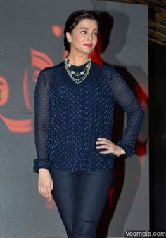 Aishwarya Rai Bachchan in a Burberry top and J Brand jeans. via Voompla.com