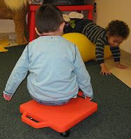 Peanut Balls and Scooter Boards - great for gross motor play