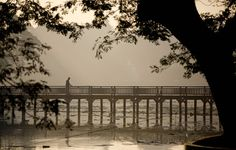 A man walks on a wooden bridge at dawn surrounded in mist on the Kandawgyi Lake in Yangon, Myanmar, Wednesday, Dec. 16, 2015. The 150-acre Kandawgyi lake surrounded by a 110-acre park is a major recreation area for Yangon residence during the dry-and relatively cool months of December to February. (AP Photo/Gemunu Amarasinghe) ORG XMIT: XGA101