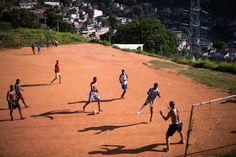 thesoccerstuff:  Boys play football in the Formiga favela, or shanty town, on November 2, 2013 in Rio de Janeiro, Brazil.