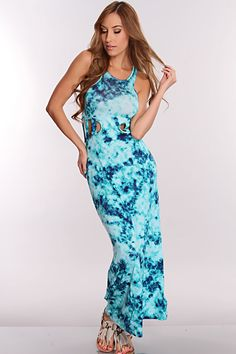 Youll sure make an apperance when you appear in this maxi dress. This look will definitely take your wardrobe to a whole new level! Make a statement with this eye catching dress! This must have dress features tie dye, round neckline, sleeveless, caged sides, and fitted. 94% Rayon 6% Spandex. Made in USA.