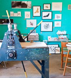 Turquoise serves as a perfect backdrop for displaying artwork in Chrissy Poitras and Kyle Topping's print studio.