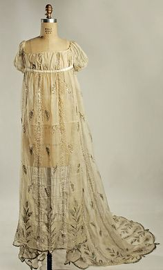 Evening dress Date: 1805–10 Culture: French Medium: cotton, metallic thread Dimensions: Length at CB: 76 1/2 in. (194.3 cm)