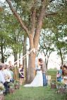 Look at the little hearts along the aisle! So cute, so simple.   Tulsa, Oklahoma Ranch Wedding from Imago Vita Photography - Style Me Pretty