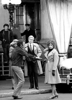 """Robert Redford and Barbra Streisand being directed by Sidney Pollack on the set of """"The Way We Were"""", 1973."""