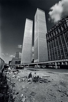 Two homeless men squat in the shadow of the recently completed World Trade Center in October, 1975. New York City was on the verge of bankruptcy and the World Trade Center sat largely vacant.