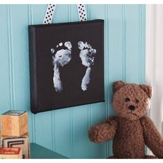 -Baby Footprints Canvas Wall Hanging- This would make such a perfect gift for Mother's or Father's Day! Found this idea on Michael's Craft Store Facebook page!