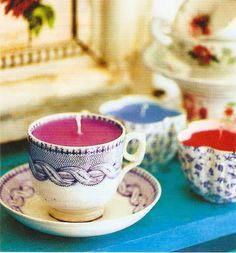 diy homemade teacup candles, would be good favors for a party maybe? Thrift to keep it cheap!