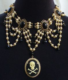 """""""Emma"""" Victorian Pirate Festoon Necklace in jet black cabochon stones, 6mm iridescent Japanese cultura pearls, and gold-plated settings.  Center pendant is a resin black and ivory skull and crossbones cameo."""