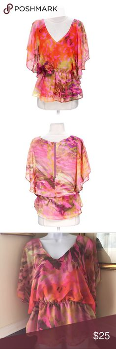 """Jennifer Lopez Tropical Paradise Blouse Lightweight and colorful blouse by JO. Zipper back closure. Elastic waist, fully lined tank underneath. Size : Large . Armpit to put 20"""". Colors: pinks/oranges/yellows. Brand new with tags. Jennifer Lopez Tops Blouses"""