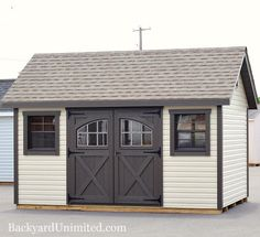 10x14 garden shed with vinyl siding carriage house doors and gable