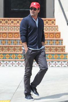 The 10 Best-Dressed Men of the Week 4.10.17 Photos | GQ  WHO: Jon Hamm Toggle WHERE: On the street in Los Angeles WHEN: April 7, 2017  WHY: Here's proof that your cozy weekend clothes don't need to be sweats. A henley and cardigan combo plus some slim khakis will give you the same comfort level, but keep you from looking like you just got off the couch.