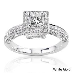 Featuring a gleaming princess cut diamond surrounded by glittering side stones, this princess cut halo engagement ring is crafted of precious 14-karat white gold. With 100 side stones in all, this beautiful ring gleams just like your love.