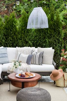 A multipurpose patio reveal with dining and lounging areas. Room to grow, eat and visit. Lush greenery and photos showing the different design arrangements.