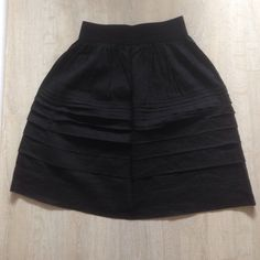 Classic black Theory skirt Versatile, comfortable, flattering classic skirt with pleats and elastic waist. 65% linen, 35% viscose. Theory Skirts