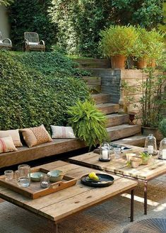 Perfect summer entertaining -- love the two outdoor coffee tables!