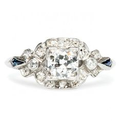 Key West is a vintage diamond and sapphire engagement ring centering a 0.47ct Round Brilliant cut diamond. Stunning! TrumpetandHorn.com | $3,150