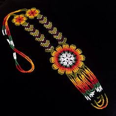 This Amazing necklaces is beaded Loom style by Trives in the coffee region of Colombia South America. The work is impeccable each necklace is a piece of art . Native American Beadwork, Crochet Accessories, Beaded Flowers, Seed Beads, Beautiful Flowers, Jewelery, Mandala, Beaded Necklace, Jewelry Making