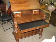 Handsome wooden secretary desk is filled with features that make it so very useful.This piece of furniture is of traditional styling and compact in proportions yet overflowing with useful features.Open the top to reveal a nice sized workspace, plus there is a slide out workspace that can handily accommodate a laptop.You'll also find a couple of compartments and drawers inside to hold smaller items that are best kept close at hand but out of sight.  Rebound Furniture & Decor    818-456-4437
