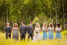 Female Groomsman in grey like the boys, but the same dress as the girls. So smart! (Moore Photography - Winnipeg and International Wedding Photography by Photographer Curtis Moore)