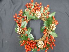 Artificial Christmas Wreath with and abundance of shiny red berries and snow dusted pine cones set on green holly leaves and spruce. Artificial Christmas Wreaths, Holly Leaf, Red Berries, Garden Furniture, Indoor Outdoor, Floral Wreath, Seasons, Holiday Decor, Berry