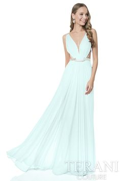 Grecian inspired mesh wrap prom gown. This prom dress features metallic sequin detail on waist and back straps.
