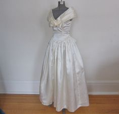 wedding dress / white satin / Gunne Saxe / 1980s / off the shoulder / full