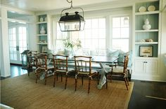 Almost exactly what I want to do in the kitchen. Flank the huge window with shelves to display all the great dishware and art. Build in a banquette under the window. Five chairs around the table. Mine will have a little more of a modern feel. Morrison Fairfax Interiors