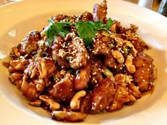 Cheesecake Factory Spicy Cashew Chicken You'll Need: 2 c. chicken breasts, cubed 5 tbsp. soy sauce 1/4 c. oil 1 tsp. red pepper flakes 3 green onions, sliced 2 garlic cloves, minced 1 1/2 tbsp. cor...