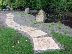 Design Farm Group rain garden with dry laid path set in native ornamental grasses