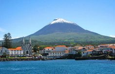 """Pico, known as """"the mountain island,"""" in the Acores of Portugal gets its name from its one tall mountain. The island can be seen from a plane even on a cloudy day because the mountain tip often pierces through the clouds in the sky."""