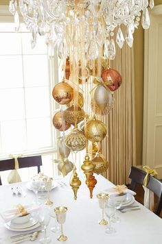 Hang some lovely ornaments from your chandelier for a suspended centerpiece.