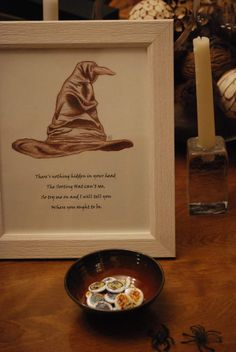From our Harry Potter themed Gender Reveal party - A Sorting Hat of sorts. Guests chose pins to show their house pride as they arrived
