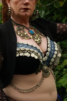 This bra is your chance to mix a few of those classic belly dance bra accents, like kuchi coins, tassels and cowrie shells into your own unique The base is a high quality lightly padded bra. The tasselling used is handmade and each one is sewn on individually for sturdiness.    The inside of the bra cup is lined with velvet, so despite the sturdy sewing it'll be a comfortable and enjoyable to wear!    In terms of fastening there are two options, I can sew velvet ties on to the bra or I can…