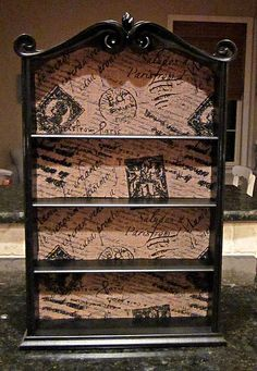 Idea for revamping an old shelf - spray paint and fabric.