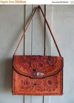 Valentines Day Sale Vintage 1960's Ladies Purse  hand tooled leather purse, Floral, Roses, Folk Art Texana style Texas Southwest design retr by TheIDconnection on Etsy https://www.etsy.com/listing/187221974/valentines-day-sale-vintage-1960s-ladies
